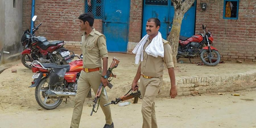 Police personnel during a search operation near the residence of main accused in the Kanpur encounter case Vikas Dubey