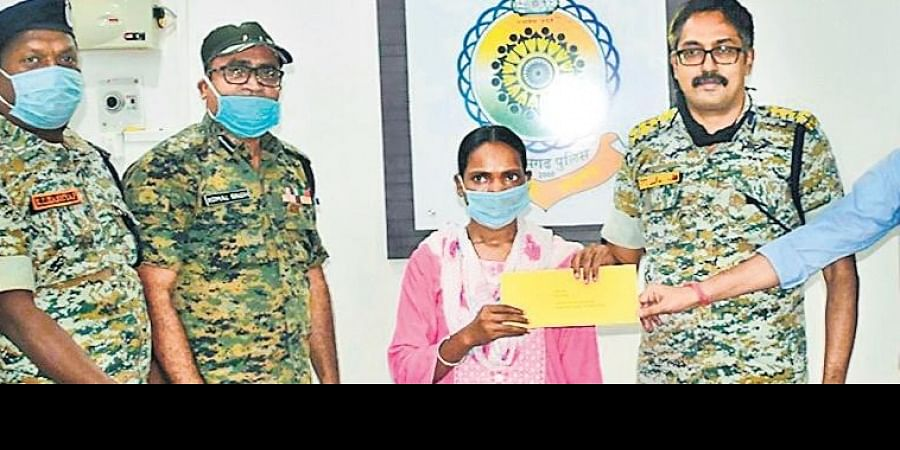 Ex-Maoist fighter Sumitra Cherpa being given an initial monetary incentive (Photo | EPS)