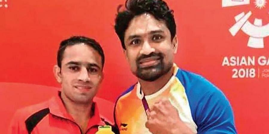 CA Kuttappa (R) & Amit Panghal