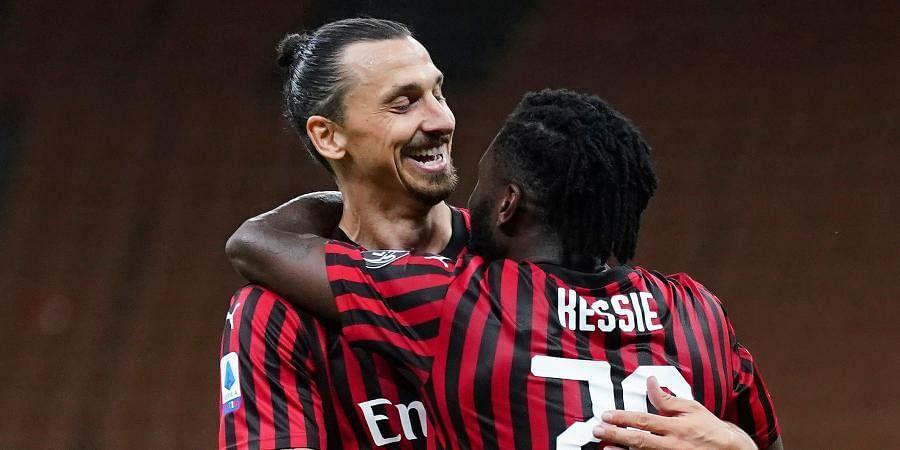 AC Milan's Franck Kessie, right, celebrates with Zlatan Ibrahimovic after scoring his side's 2nd goal during the Serie A soccer match between AC Milan and Juventus at the Milan San Siro Stadium.