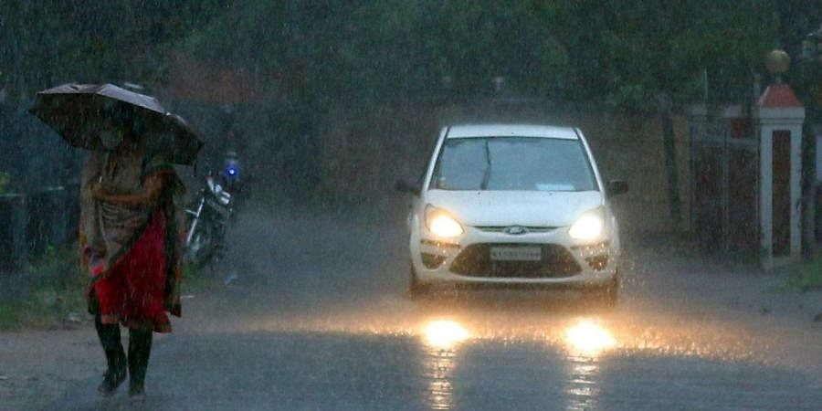 A woman caught in rain. (Photo  EPS)