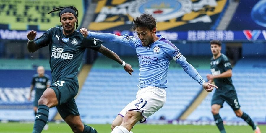 Manchester City's David Silva shots past Newcastle's Valentino Lazaro, left, during the English Premier League soccer match between Manchester City and Newcastle. (Photo | AP)