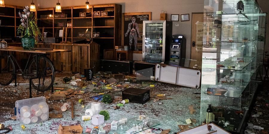 CBD Kratom is damaged after looting broke out in the Loop and surrounding neighborhoods overnight, Monday morning, Aug. 10, 2020.