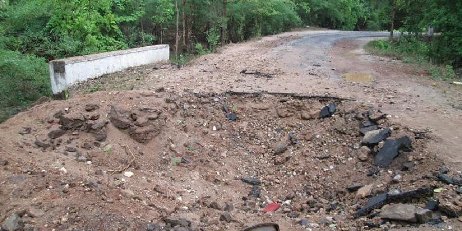 A deep crater-like structure formed on the NH-16 in Bastar after the IED blast triggered by Maoists.