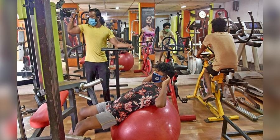 Fitness enthusiasts seen at a gym in Chennai after it reopened on Monday; Sri Hamsavinayakar temple, Padi, opened its door after norms were relaxed