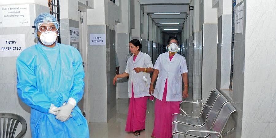 A nurse wearing a n95 mask at Thrissur Medical College Hospital.