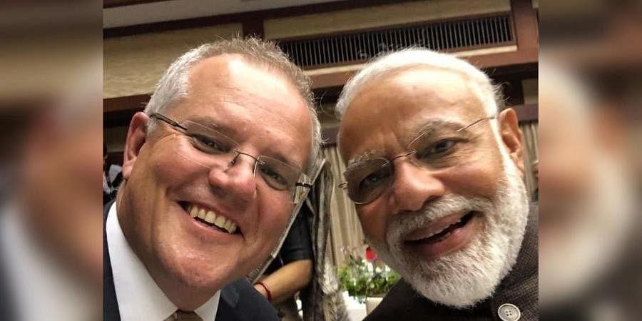 Australian Prime Minister Scott Morrison (L) and PM Narendra Modi click a selfie