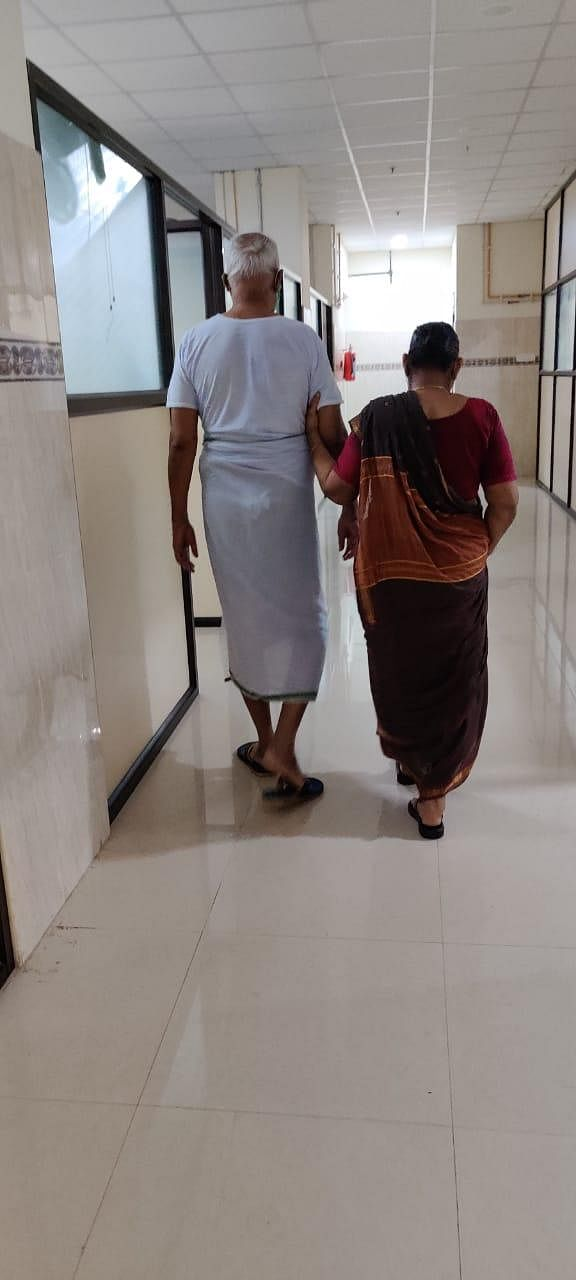Made For Each Other - At 06:00 PM, An evening walk along walk the vast corridors of the hospital helps the elderly couple feel at home. (Photo | EPS/Shiba Prasad Sahu)