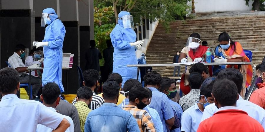 Health workers collect swab samples at an open-air theatre in Mysuru on Monday | Uday shankarS