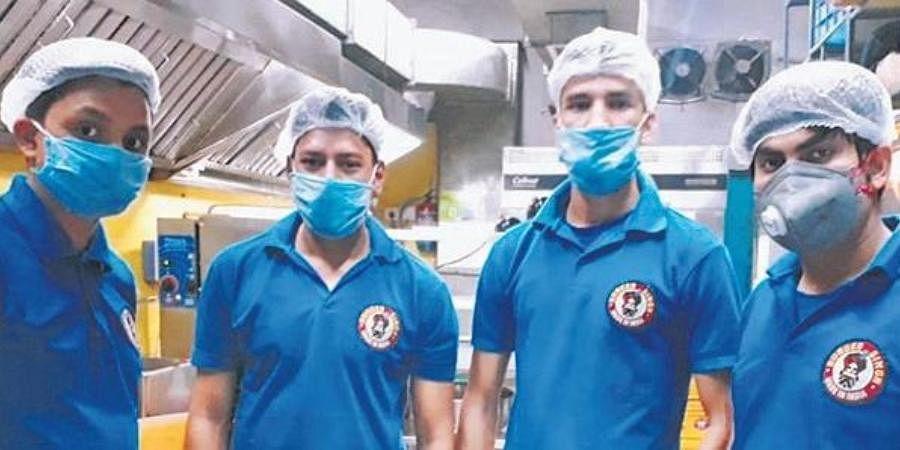 Employees at Burger Singh