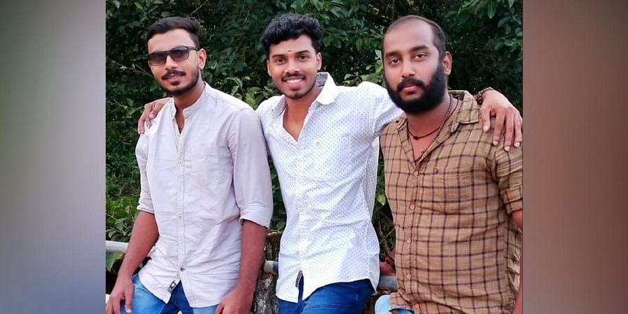 Nandu Mahadeva, centre, with his friends