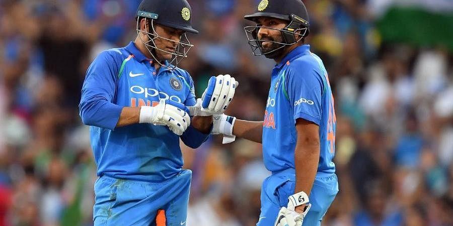 India's batsmen Mahendra Singh Dhoni (L) and Rohit Sharma. (Photo | AFP)