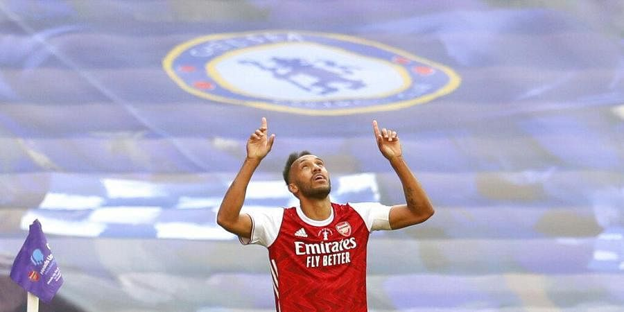 Arsenal's Pierre-Emerick Aubameyang celebrates after scoring his side's second goal during the FA Cup final soccer match between Arsenal and Chelsea at Wembley stadium in London. (Photo | AP)