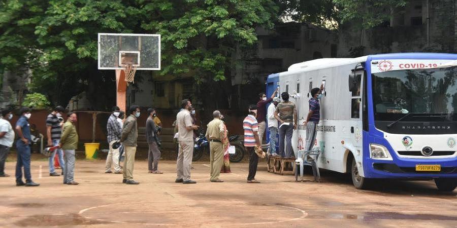Public stand in a queue for COVID-19 testing at IGMC stadium in Vijayawada