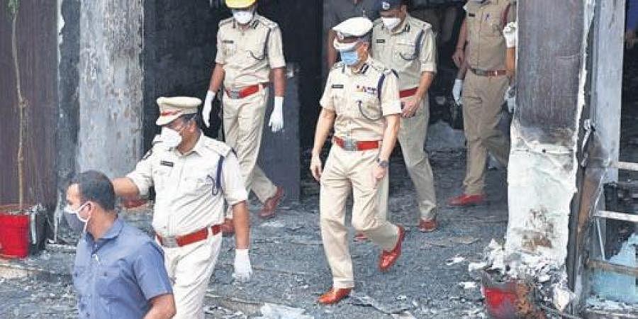 DGP Gautam Sawang visits Swarna Palace Hotel after the fire incident in Vijayawada on Sunday (Photo | Prasant Madugula, EPS)