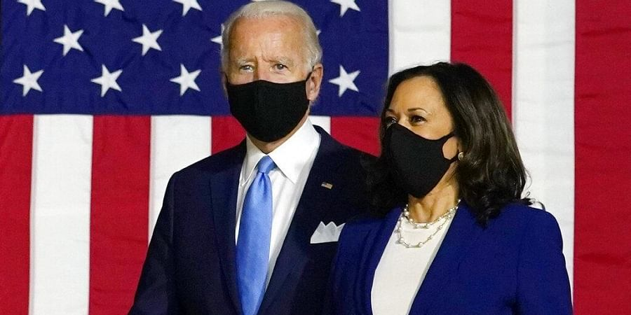 Democratic presidential candidate former Vice President Joe Biden and his running mate Sen. Kamala Harris, D-Calif., arrive to speak at a news conference in Wilmington (Photo | AP)