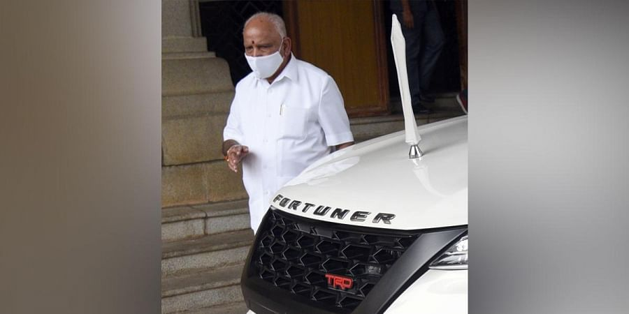 Chief Minister B S Yediyurappa leaves after attending a cabinet meeting. He is expected to travel to Delhi