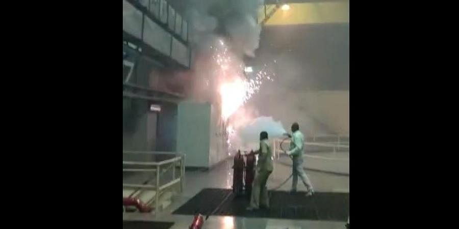 Employees trying to douse the fire in the Srisailam Hydro Electric power plant.