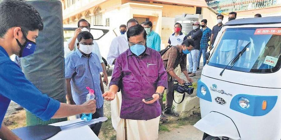 Industries Minister E P Jayarajan flagging off 15 e-autos in Thiruvananthapuram
