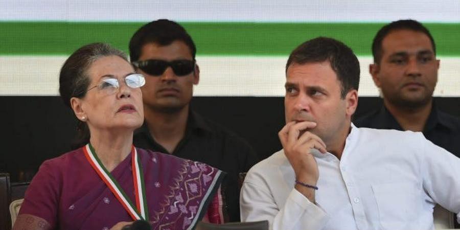 Congress interim president Sonia Gandhi with Rahul Gandhi