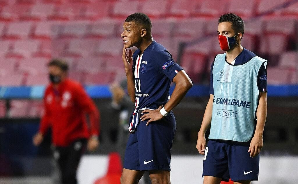 PSG's Kylian Mbappe, left, stands on the pitch disappointed after losing the Champions League final.  (Photo | AP)