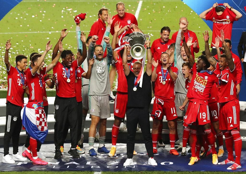 Bayern's head coach Hans-Dieter Flick, center, raises the trophy along with players after defeating PSG 1-0. With this win, Bayern have won the UCL for the sixth time.   (Photo | AP)