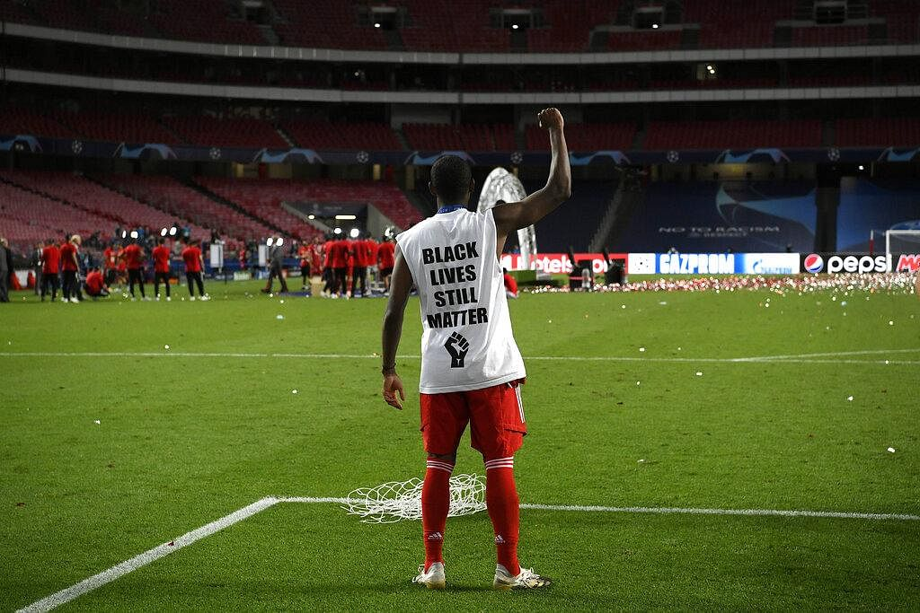 Bayern's David Alaba celebrates the win by supporting the Black Lives Matter movement with a message on his T-shirt. (Photo | AP)
