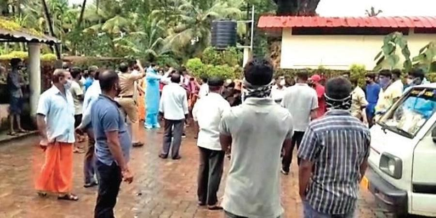 The family of a COVID victim stages a protest along with locals after they were handed over the wrong body in Kundapur taluk on Sunday.