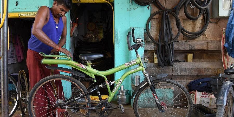 A mechanic repairs a bicycle in a cycle repairing and rental shop in Tiruchy. (Photo  EPS/ MK Ashok Kumar)