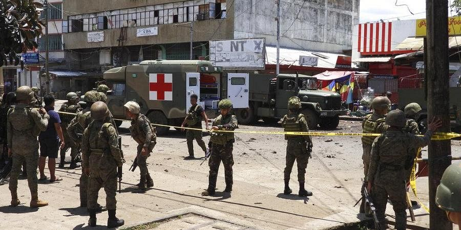 Police and military secure the site of an explosion in the town of Jolo, Sulu province southern Philippines on Monday Aug. 24, 2020. (Photo | AP)