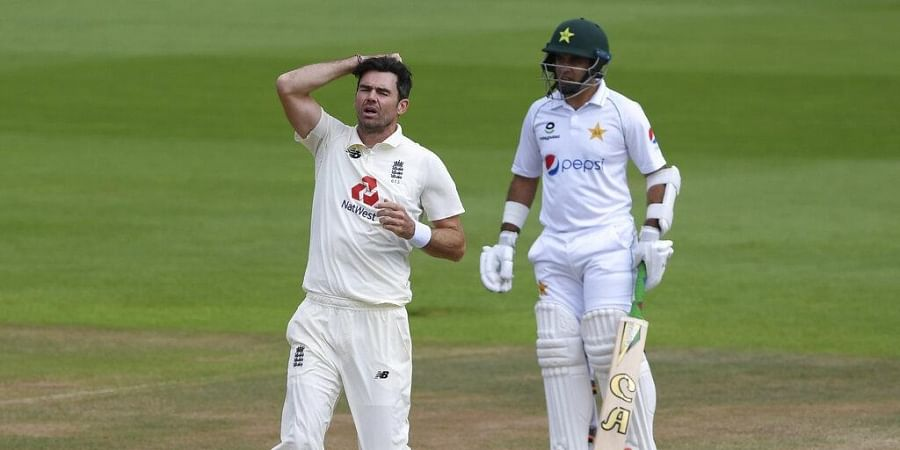 England's James Anderson, left, reacts a after teammate Jos Buttler dropped a catch during the fourth day of the third cricket Test match between England and Pakistan. (Photo   AP)