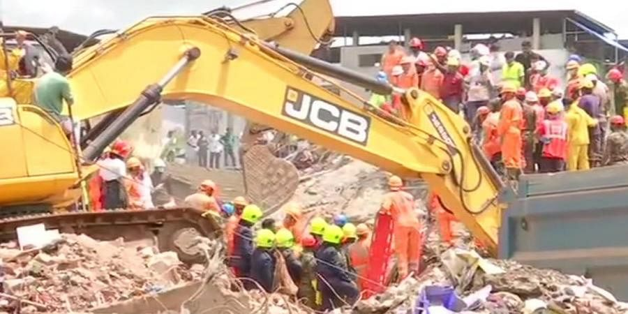 Maharashtra: National Disaster Response Force continues rescue operations at the site of building collapse in Raigad.