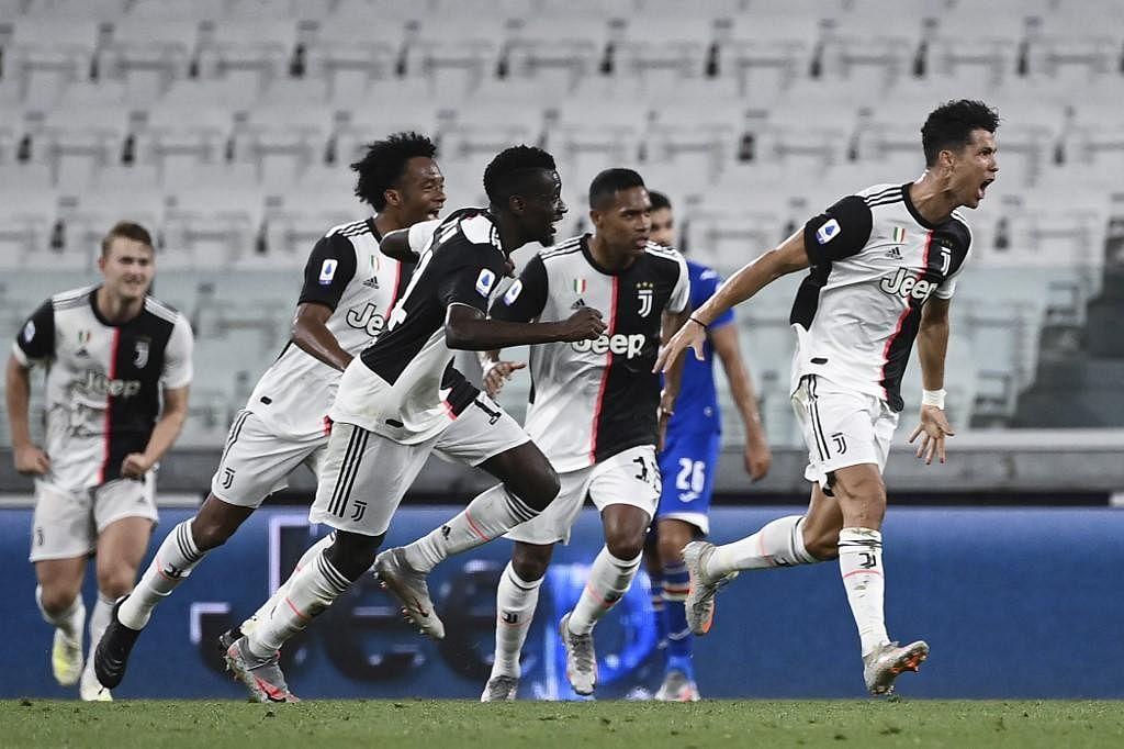 Juventus' Portuguese forward Cristiano Ronaldo (R) celebrates after scoring during the Italian Serie A football match. (Photo | AFP)