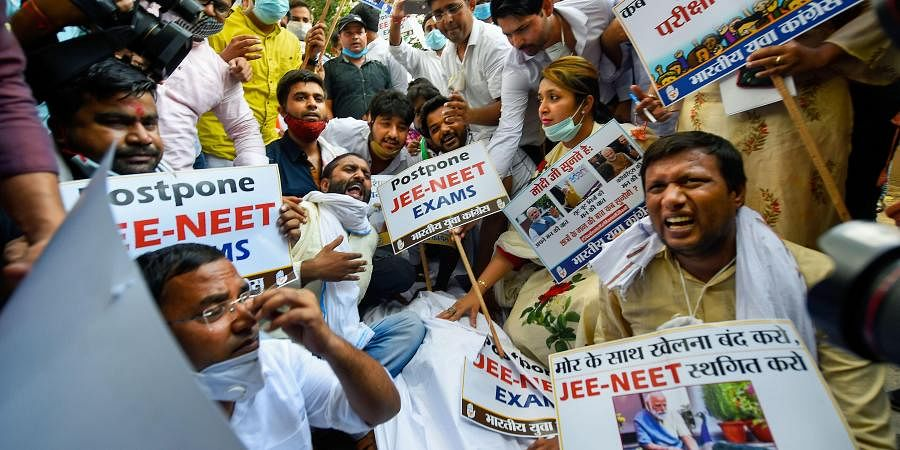 Indian Youth Congress workers stage a protest outside the HRD Ministry for organising JEE-NEET Examination amid COVID-19 pandemic in New Delhi. (Photo | PTI)