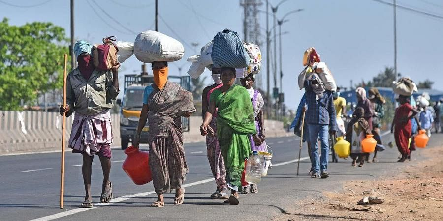 Migrant labourers walking back home during lockdown due to coronavirus pandemic