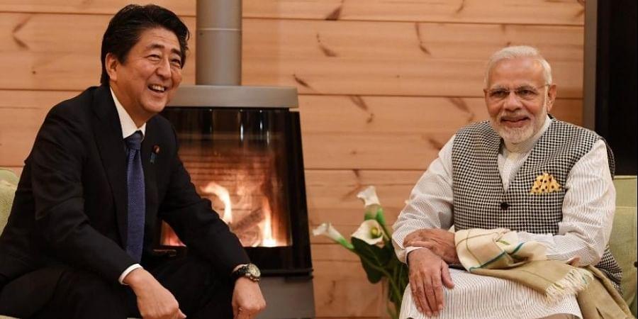 Japan Prime Minsiter Shinzo Abe (L) with PM Narendra Modi (R). (Photo | Narendra Modi Twitter)