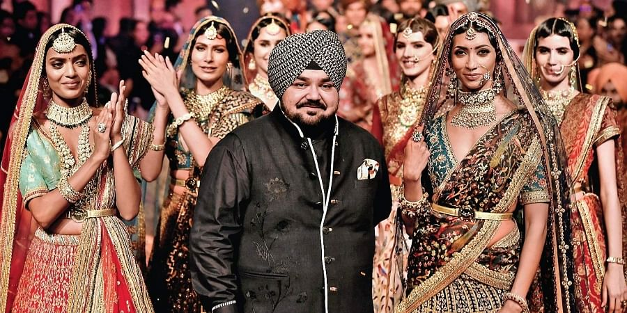 JJ Valaya flanked by models during his recent show in Delhi