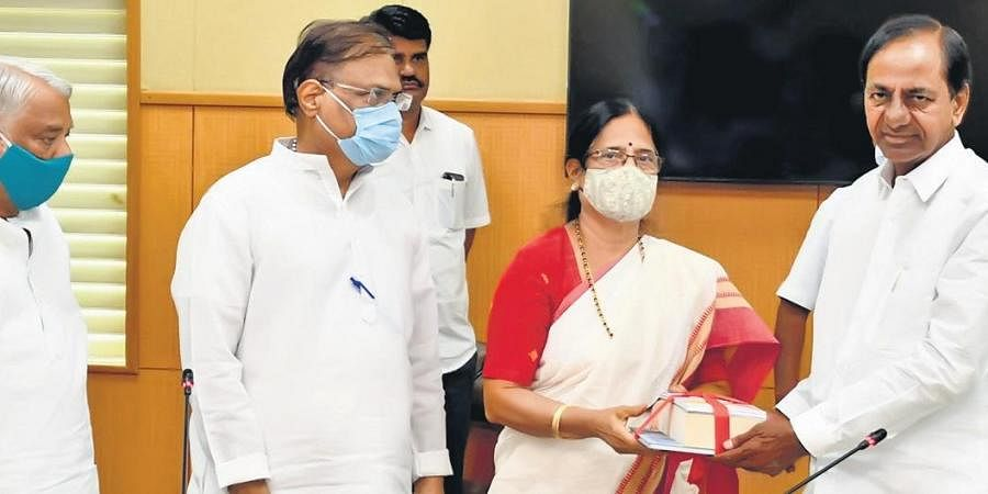 Vani Devi, daughter of former Prime Minister PV Narasimha Rao, presents a set of books authored by her father to  Chief Minister K Chandrasekhar Rao at Pragathi Bhavan, in Hyderabad on Friday