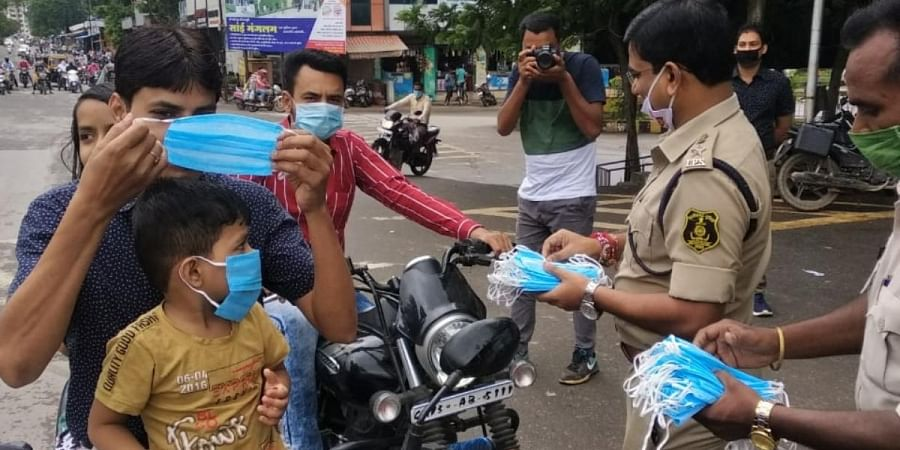 Raigarh police force distributing of face masks to people as part of awareness drive.
