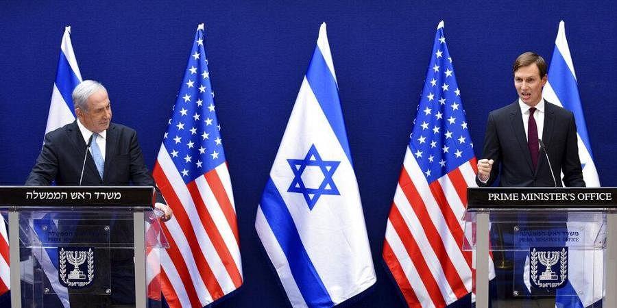 Israeli PM Benjamin Netanyahu, left, and White House adviser Jared Kushner make joint statements to the press about the Israeli-United Arab Emirates peace accords, in Jerusalem. (Photo   AP)