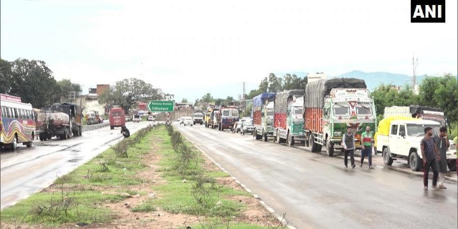 File photo of vehicles stranded due to landslide. |