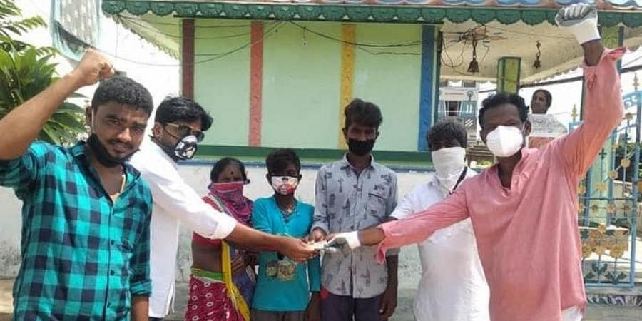 Local youths giving contribution to the elderly couple K Gavarayya and Rajulamma of Tekkali in Srikakulam
