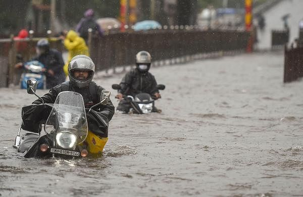 Heavy rains batter Mumbai; local trains, road traffic hit hard
