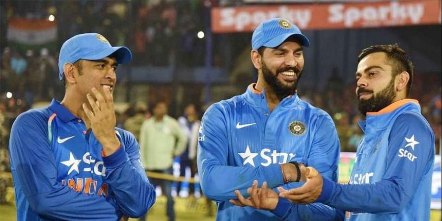 Indian skipper Virat Kohli (L) having a casual chat with  Yuvraj Singh (C) and MS Dhoni (Photo   AFP))
