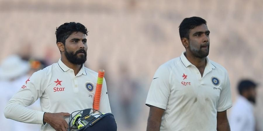 Ravindra Jadeja (L) and R. Ashwin. (Photo | AFP)