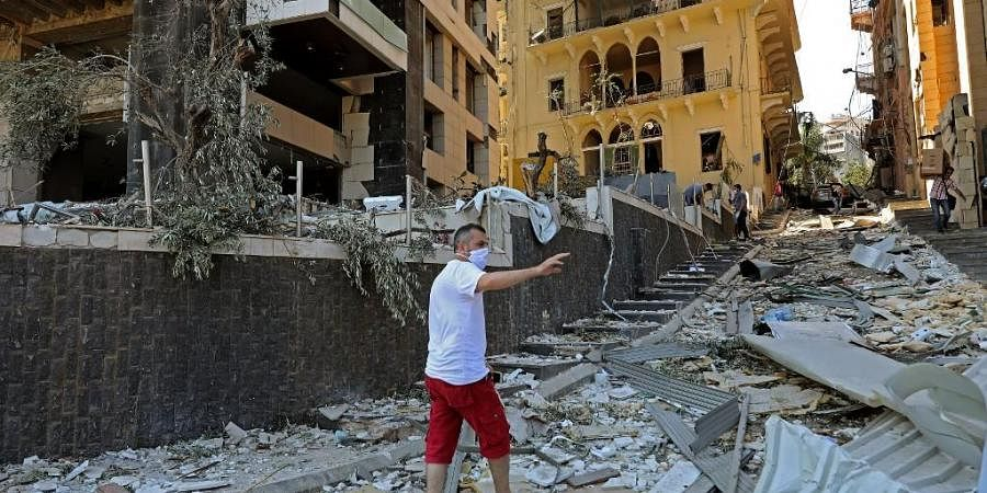 A man inspects the damage of August 4 blast that tore through Lebanon's capital Beirut. (Photo  AFP)