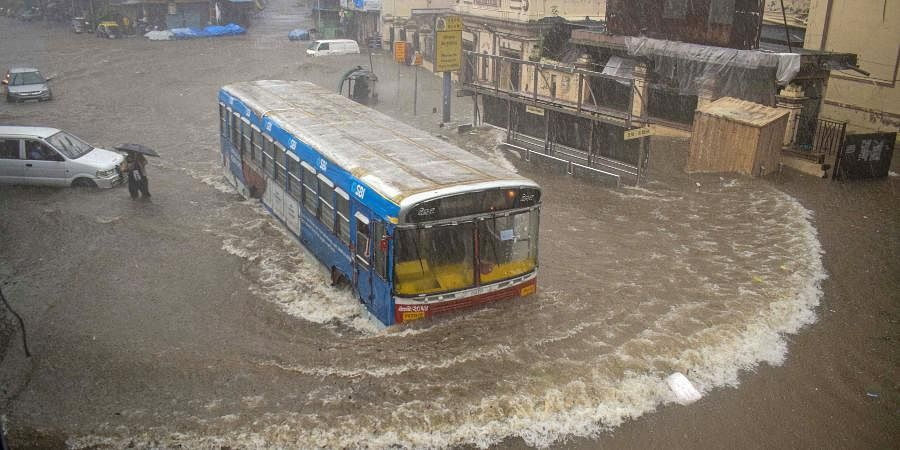 Vehicles ply on a waterlogged street during heavy rains at Byculla area in Mumbai.