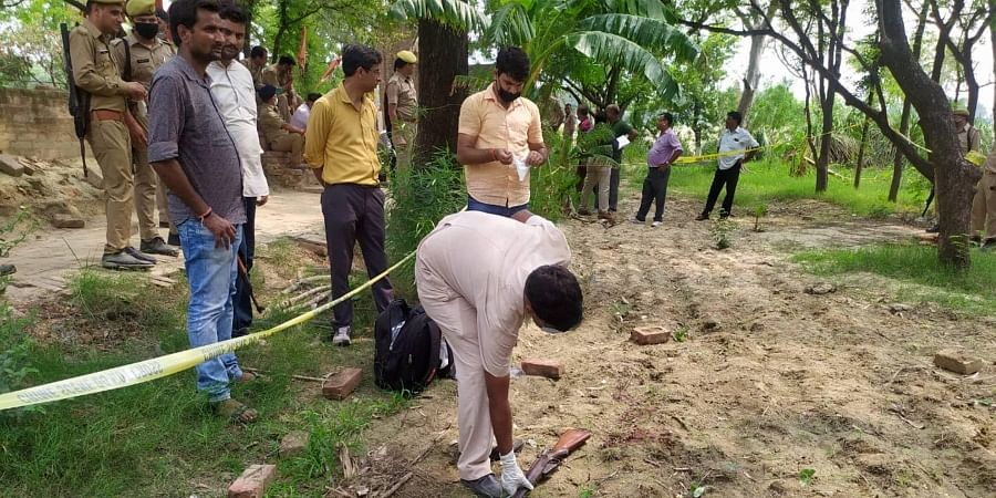 Kanpur Police and forensic team members investigate the encounter site where 8 police personnel lost their lives after being fired upon by criminals in Kanpur Friday July 3 2020.