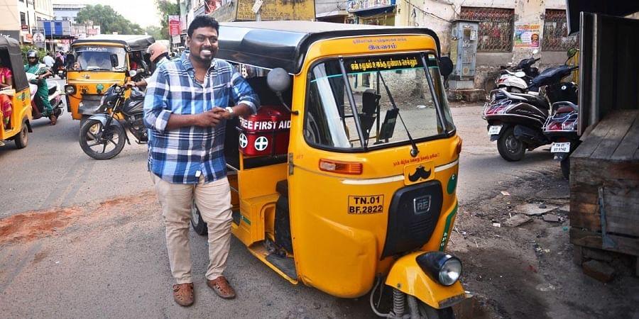 D Arul Raj with his autorickshaw