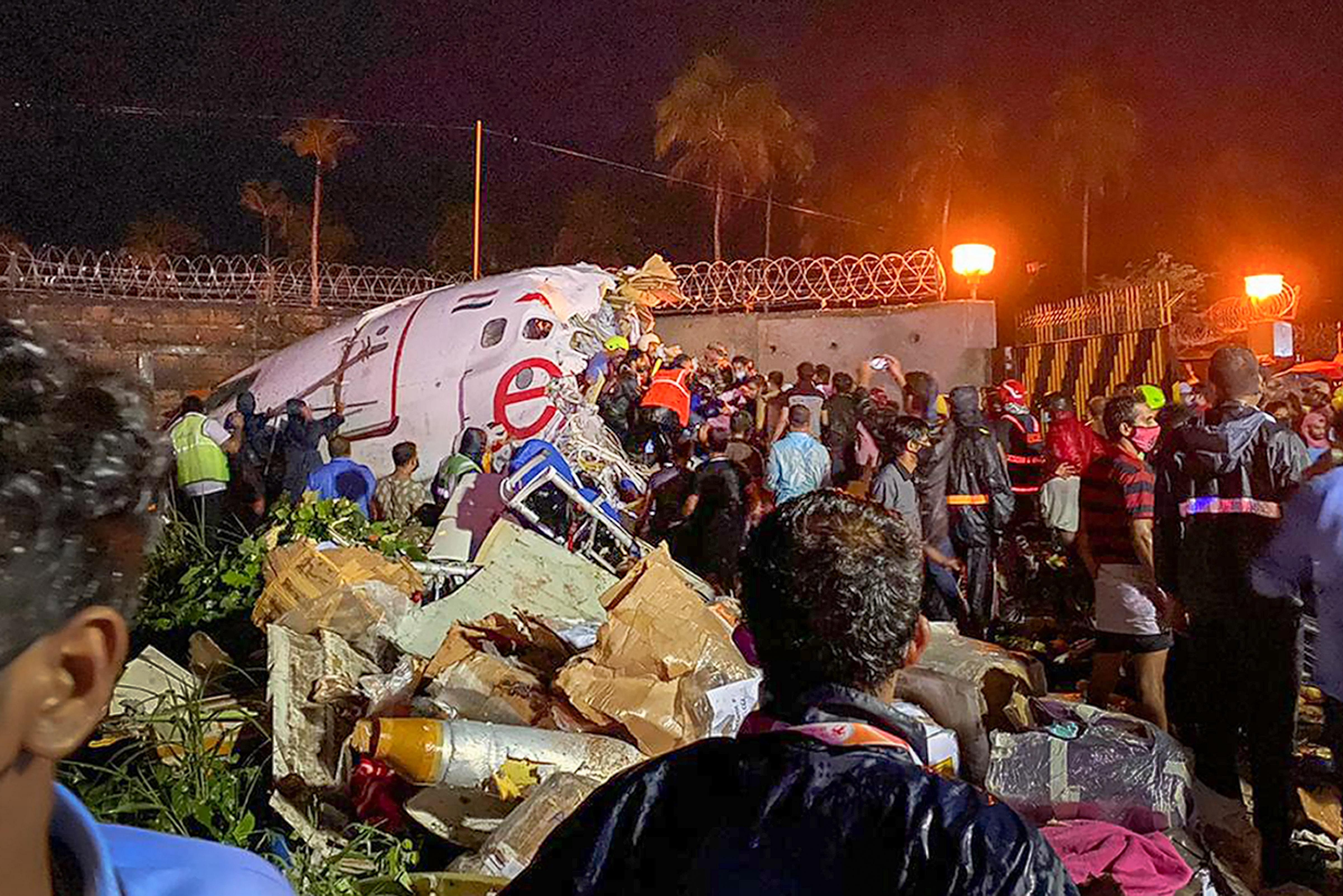 On the day rains ravaged many parts of Kerala, another tragedy happened when the Air India Express flight skidded off the runway while landing in bad weather at Kozhikode International Airport.  At least 18 persons including the pilots died and over 40 grievously injured due to the accident. (Photo | PTI)